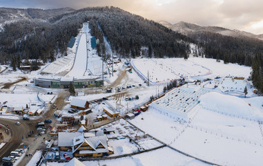 Large ski jump in Zakopane called Huge Krokiew names Stanislawa Marusarza, winter aerial view.