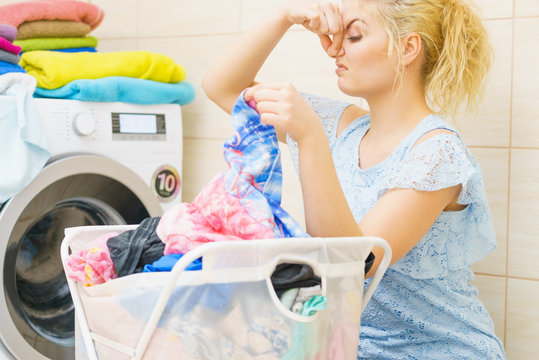 Woman dealing with stinky laundry