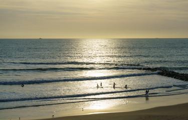Sunset on Santa Maria del Mar beach in Cadiz, Andalusia, Spain