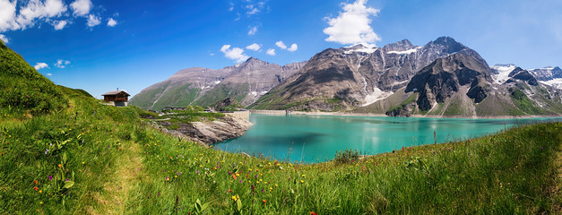Panoramic view of Reservoir Mooserboden embedded in the impressive mountains of the Hohe Tauern near Kaprun, Austria. Fototapete