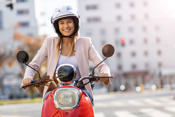 Woman Riding Scooter In The City