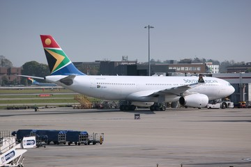 LONDON, UK - APRIL 16, 2014: Airbus A330-200 of South African Airways at London Heathrow airport. The airline is owned by Government of South Africa and flies to 42 destinations.