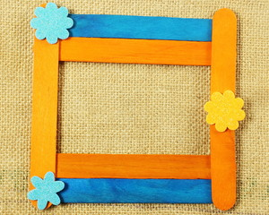 wooden popsicle stick frame isolate with copy space as background