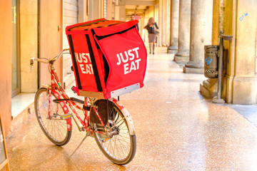 Bologna, italy, oct 16 2016: a JUST EAT container on a bike used for the deliveries under the Bologna's porticos. JUST EAT s an online food order and delivery service based in UK
