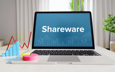 Shareware – Statistics/Business. Laptop in the office with term on the display. Finance/Economics.