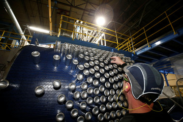 Aluminium cans leave the production line at Ball Corporation, Wakefield