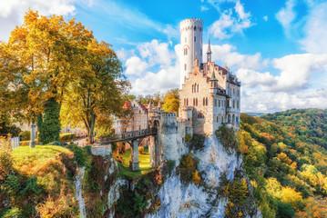 Germany, Lichtenstein Castle in Baden-Wurttemberg land in Swabian Alps. Seasonal view of  Lichtenstein Castle on a cliff circled by trees with yellow foliage. European famous landmark. Fototapete
