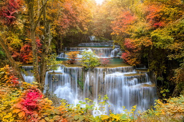 Printed kitchen splashbacks Melon Beautiful and colorful waterfall in deep forest during idyllic autumn