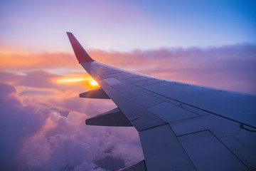Beautiful sunset, sky on the top view, airplane flying view from inside window aircraft of Traveling.