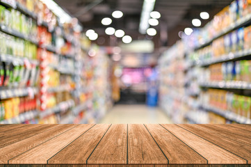 Empty top wooden table with supermarket blur background