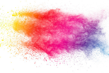 Colorful background of pastel powder explosion.Multi colored dust splash on white...