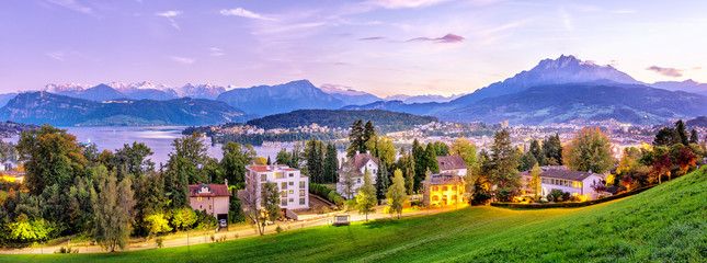 Wall Mural - Switzerland, Lucerne city. Panoramic view on downtown of Lucerne from the hill top near city conservatory. Aerial view during twilight. Picturesque city landscape. Autumn season.