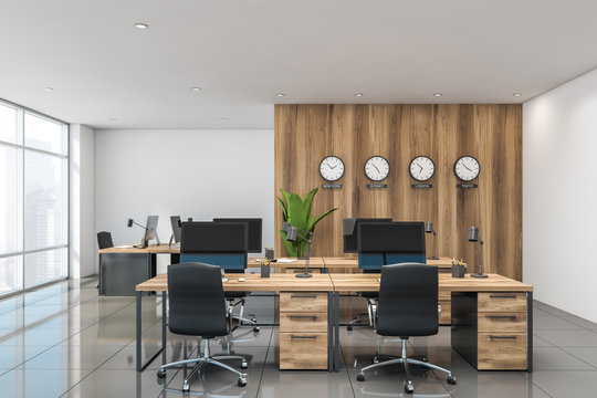 Wooden office interior with clocks