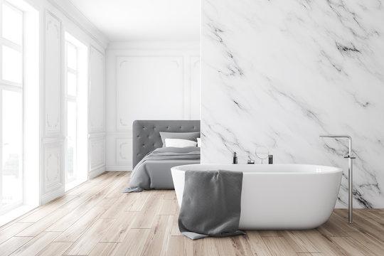 Luxury white marble bedroom and bathroom, tub