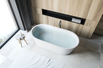Top view of white tile floor bathroom with tub