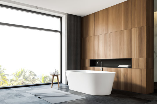 Grey tile floor panoramic bathroom corner with tub