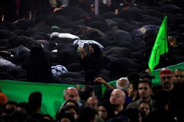 A female Shi'ite Muslim pilgrim takes a selfie during the prayer ahead of the holy Shi'ite ritual of Arbaeen