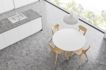 Top view of stylish kitchen with round table