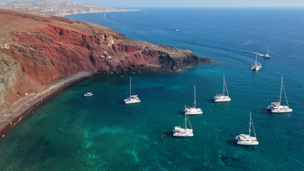 Türaufkleber Santorini Aerial drone photo of iconic famous red rocky volcanic beach with deep turquoise sea visited by sail boats, Santorini island, Cyclades, Greece