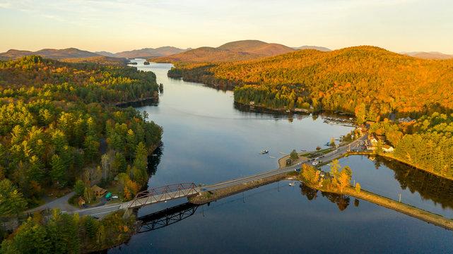 Sunset over Highway 30 Crossing Long Lake at Adirondacks Park Upstate NY