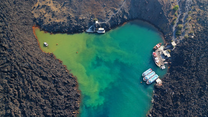 Spoed Foto op Canvas Santorini Aerial drone top down photo of iconic main Crater of Santorini volcanic island called Kameni visited by tourist boats, Cyclades, Greece