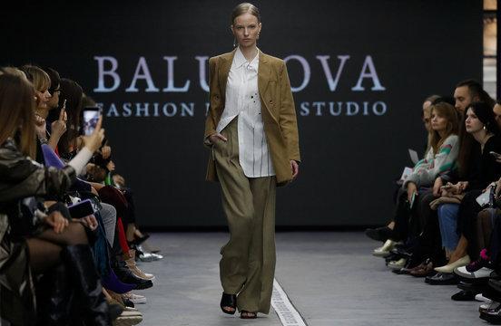 Model presents a creation by Balunova fashion design studio during a show at Belarus Fashion Week in Minsk