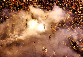 Riot police fire tear gas to disperse demonstrators during a protest targeting the government over an economic crisis, near the government palace in Beirut