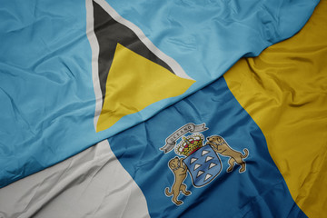 Photo sur Toile Iles Canaries waving colorful flag of canary islands and national flag of saint lucia.