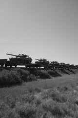 Military tanks carried on railway carrier track