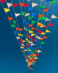 Colorful flags in blue sky