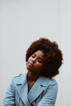 Portrait of young woman with afro hairstyle