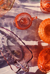 Overhead view of colorful vintage glass tableware
