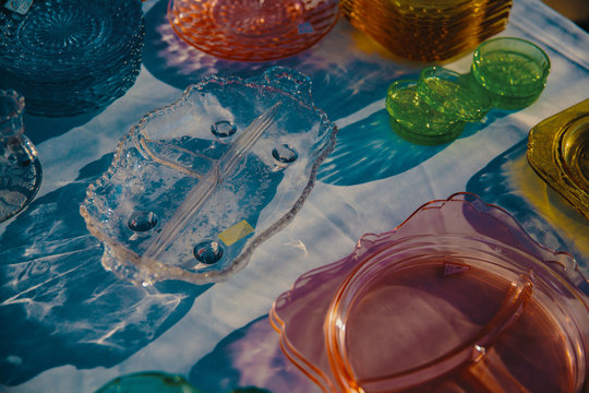 Variety of colorful vintage glass trays and plates