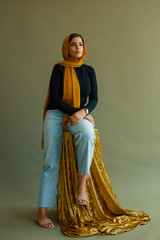 Portrait of young woman in a hijab and jeans