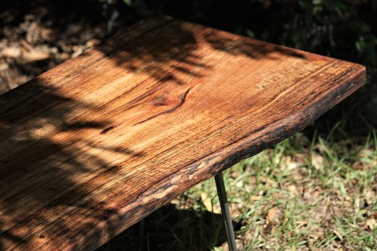 milled wooden slab in the oak shadows