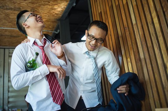 two businessman is drunk and laughing after drinking hard in restaurant to celebrate the success of work. concept of winner and business successful