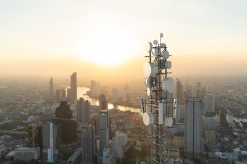 Telecommunication tower with 5G cellular network antenna on city background Wall mural