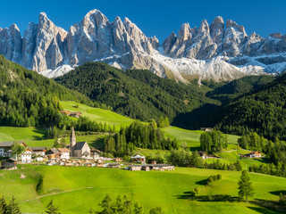 Italy, september 2017: St. Magdalena with its characteristic church in front of the Geisler Dolomites mountain peaks in the Villnosstal in autumn.