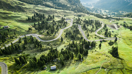 Wall Mural - Aerial view of winding road at Passo Gardena, Dolomites