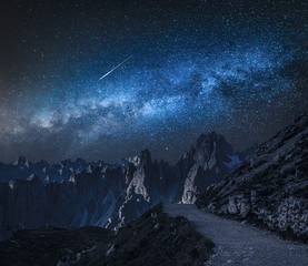 Wall Mural - Milky way over mountain path to Tre Cime, Dolomites
