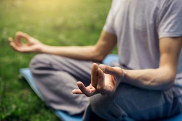 Meditation man's hands yoga gestur  in nature. Yoga fingers