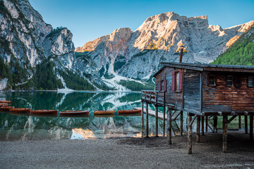 Wall Mural - Famous Lago di Braies and wooden hut at sunrise, Dolomites