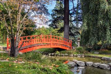 A red wooden bridge in a japanese garden - Albert Kahn Park, Boulogne-Billancourt near Paris, France
