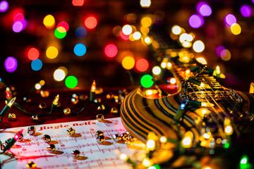 Guitar Music for the holiday season.  Jingle Bells sheet music minature bells and Christmas lights...