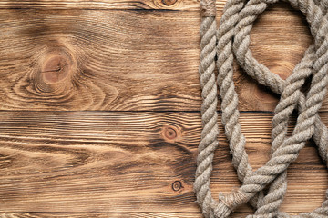Rope on brown wooden floor background with copy space.