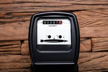Kilowatt Meter On Wooden Desk