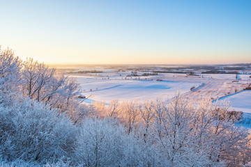 Wintry landscape view over the countryside at sunset