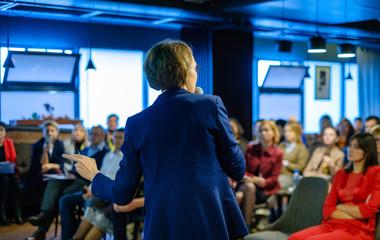 Female presenter speaks to audiences