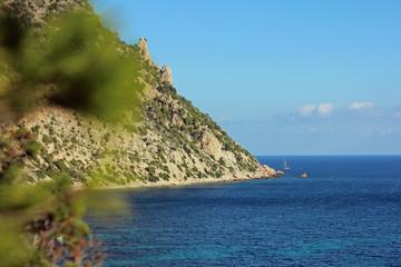 Ibiza coast at clear blue sky