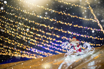Defocused Christmas themed background with snowflakes. Christmas market theme.